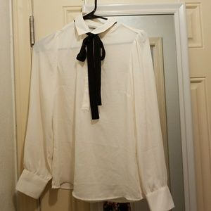 White collared blouse with black neck tie